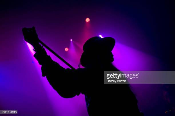 S BUSH EMPIRE Photo of FIELDS OF NEPHILIM and Carl McCOY Carl McCoy performing on stage silhouette