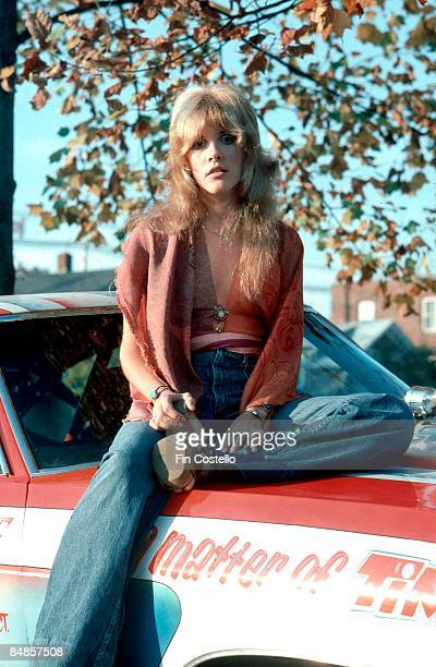 HAVEN Photo of FLEETWOOD MAC and Stevie NICKS of Fleetwood Mac posed sitting on car