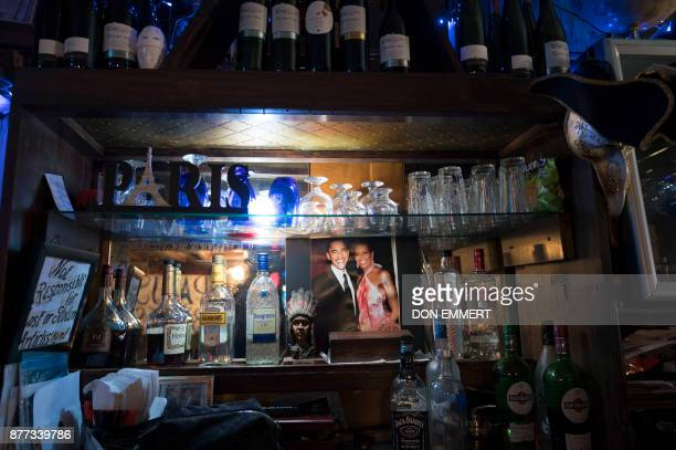 A photo of former US President Obama and his wife Michelle hangs on the wall of Paris Blues jazz bar in Harlem on November 17 2017 in New York In...