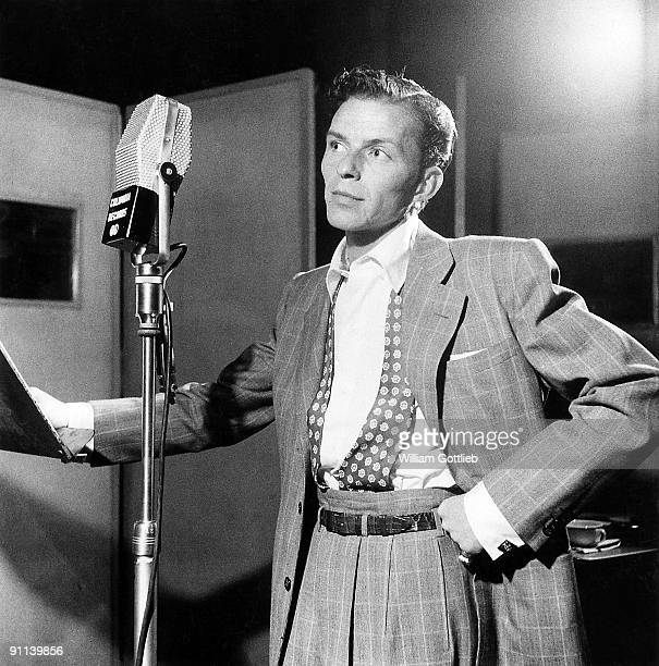Photo of Frank SINATRA posed next to microphone recording at Columbia Recording studios Liederkrantz Hall