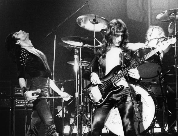 Photo of Freddie MERCURY and John DEACON and QUEEN
