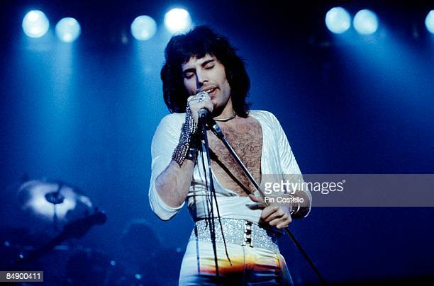 Photo of Freddie MERCURY and QUEEN; Freddie Mercury performing live on stage,