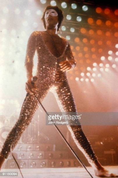 Photo of Freddie MERCURY and QUEEN Freddie Mercury performing live on stage sequins and mask