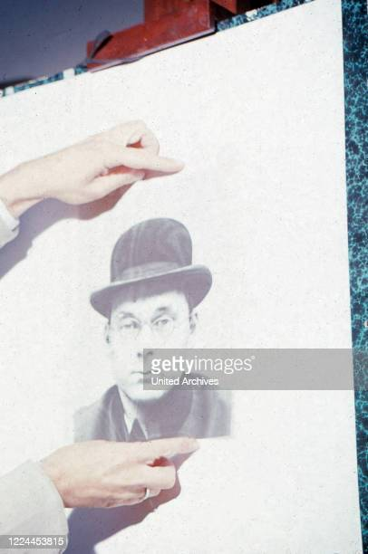 Photo of French drawer and satirist Sine, aka Maurice Albert Sinet wearing glasses and a bowler hat, France around 1962.