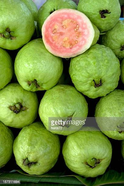 photo of fresh guavas with one cut in half - guava fruit stock photos and pictures
