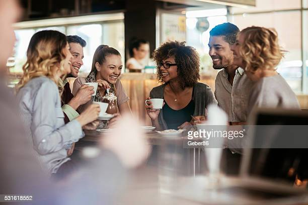 Photo of friends having coffee in cafe