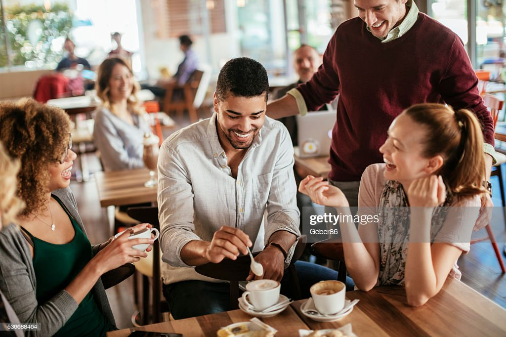 Photo of friends having coffee in cafe : Stock Photo