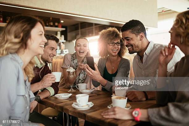 photo of friends having coffee in cafe - coffee drink stock pictures, royalty-free photos & images