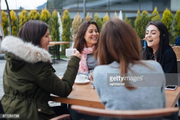 photo of friends having coffee in cafe - quattro persone foto e immagini stock