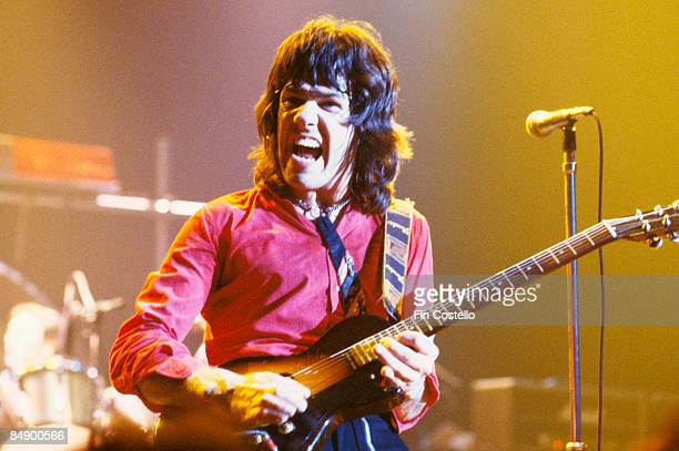 ODEON Photo of Gary MOORE and THIN LIZZY Gary Moore performing on stage 446
