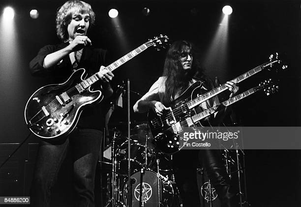Photo of Geddy LEE and Alex LIFESON and RUSH LR Alex Lifeson and Geddy Lee performing live onstage on Permanent Waves tour