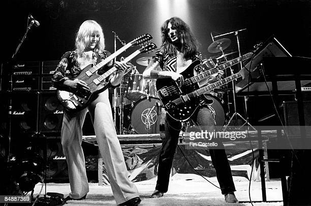 USA Photo of Geddy LEE and Alex LIFESON and RUSH LR Alex Lifeson Geddy Lee performing live onstage on All The World's A Stage tour