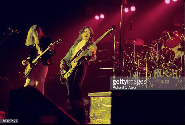 FESTIVAL Photo of Geddy LEE and Alex LIFESON and RUSH LR Alex Lifeson Geddy Lee Neil Peart performing live onstage at the Academy Of Music