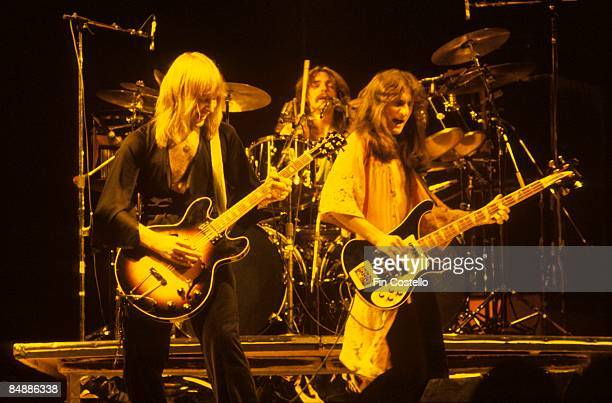 Photo of Geddy LEE and Alex LIFESON and RUSH LR Alex Lifeson Neil Peart Geddy Lee performing live onstage on All The World's A Stage tour