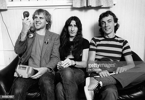 Photo of Geddy LEE and RUSH and Alex LIFESON and Neil PEART LR Alex Lifeson Geddy Lee Neil Peart posed group shot backstage on Permanent Waves tour