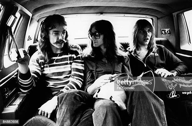CHICAGO Photo of Geddy LEE and RUSH and Alex LIFESON and Neil PEART LR Neil Peart Geddy Lee Alex Lifeson posed group shot sitting in back of car on...