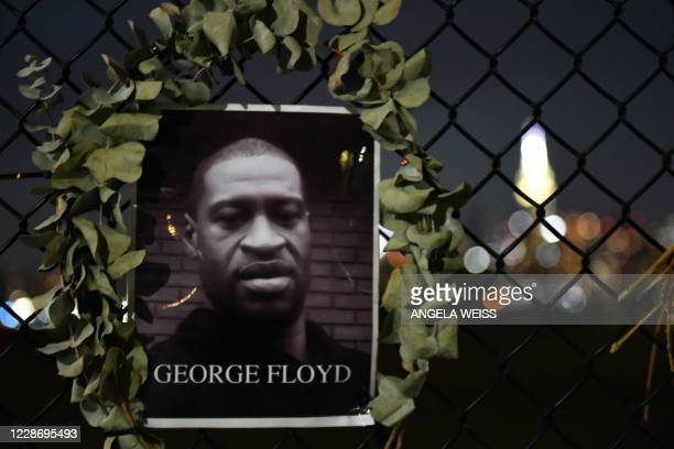 A photo of George Floyd is pictured on a fence alongside other victims of police brutality in the Brooklyn borough of New York City on September 24...