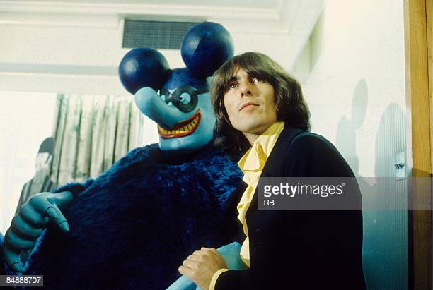 Photo of George HARRISON and BEATLES George Harrison with a Blue Meanie at the press screening of the film 'Yellow Submarine'