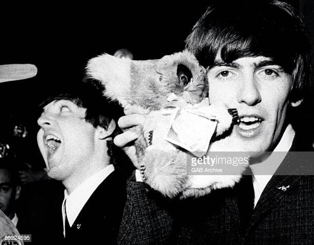 Photo of George HARRISON and BEATLES of The Beatles posed with koala soft toy on Australian tour
