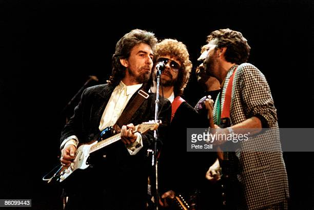 ARENA Photo of George HARRISON and Eric CLAPTON and Jeff LYNNE LR George Harrison Jeff Lynne Donald 'Duck' Dunn Eric Clapton performing live onstage...