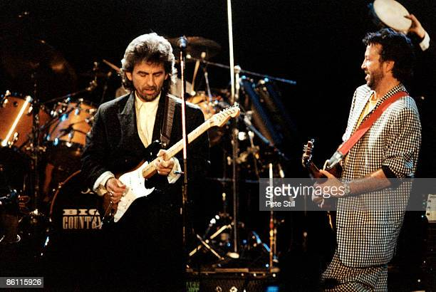 Photo of George HARRISON and Eric CLAPTON with Eric Clapton performing live onstage at the Princes Trust Concert