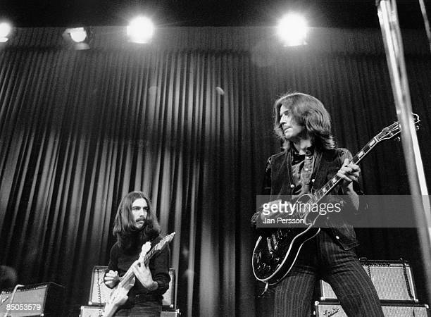 Photo of George HARRISON and Eric CLAPTON with George Harrison performing live onstage with Delaney Bonnie