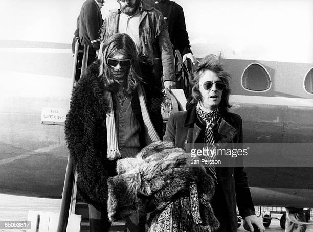 Photo of George HARRISON and Eric CLAPTON with George Harrison getting off aircraft on Delaney Bonnie tour