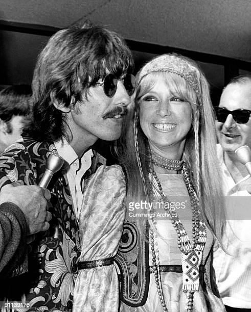 Photo of George HARRISON and Patti BOYD and BEATLES; of The Beatles, with his wife Patti Boyd returning to the UK from the USA