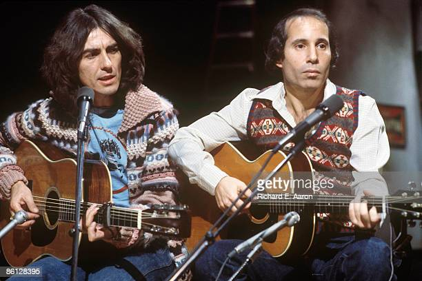Photo of George HARRISON and Paul SIMON LR George Harrison Paul Simon performing on Saturday Night Live
