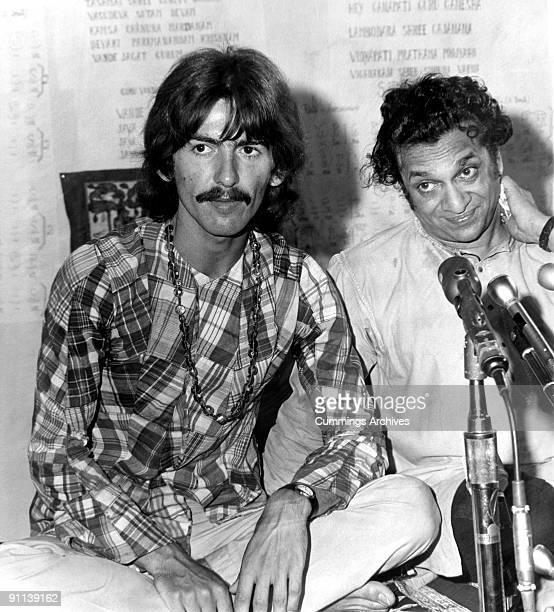Photo of George HARRISON and Ravi SHANKAR and BEATLES, of The Beatles, meeting Ravi Shankar