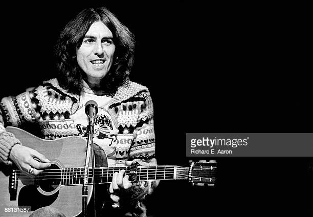 Photo of George HARRISON; George Harrison performing on Saturday Night Live, acoustic guitar