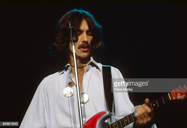 Photo of George HARRISON; George Harrison performing on stage, Dark Horse Tour