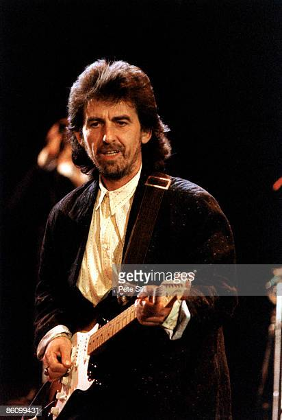 Photo of George HARRISON, performing live onstage at the Princes Trust Concert