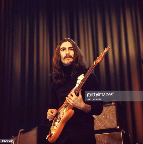 Photo of George HARRISON performing live onstage with Delaney Bonnie playing 'Rocky' Fender Stratocaster guitar
