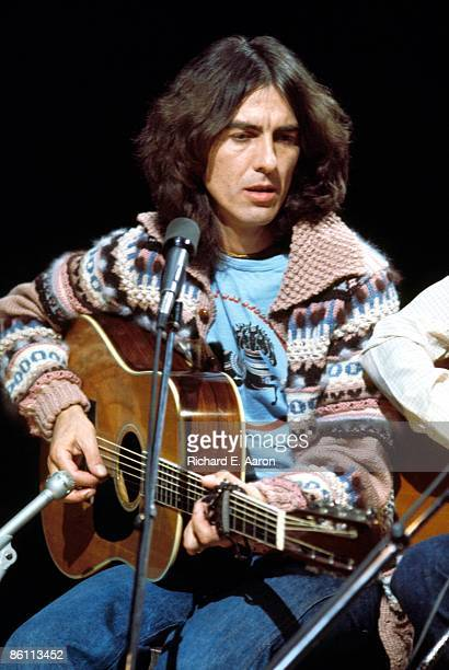 Photo of George HARRISON performing on Saturday Night Live playing acoustic guitar