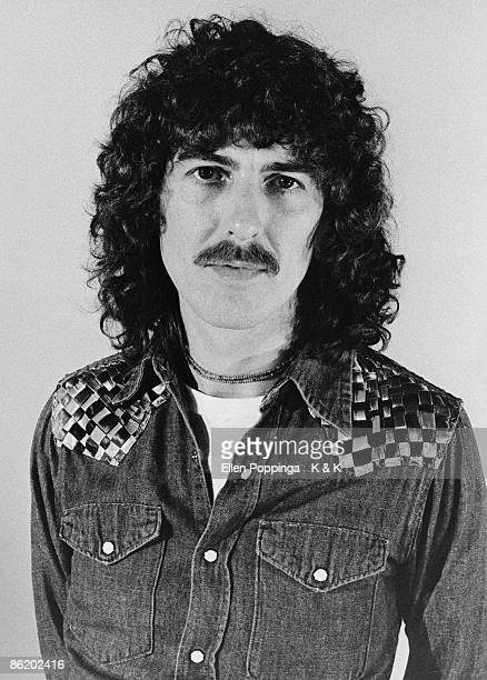Photo of George HARRISON posed studio with permed hair