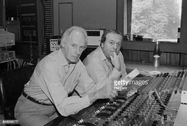 STUDIOS Photo of George MARTIN and Geoff EMERICK George Martin and Geoff Emerick posed at mixing desk in Abbey Road Studios