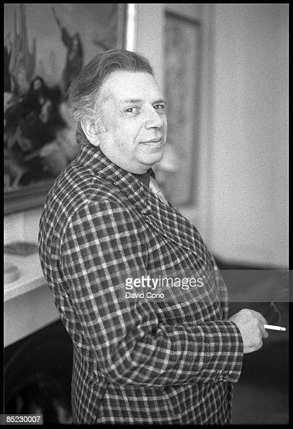 Photo of George MELLY posed at Notting Hill home