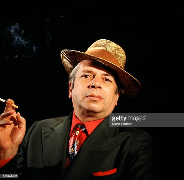 Photo of George MELLY Posed studio portrait of George Melly smoking cigarette