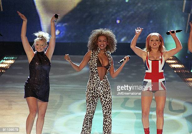 Photo of Geri HALLIWELL and Mel B and Emma BUNTON and SPICE GIRLS, L-R Emma Bunton, Melanie Brown and Geri Halliwell, in Union Jack dress performing...