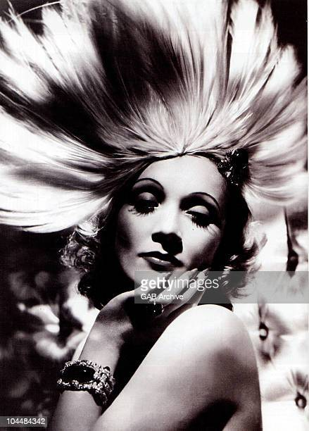 Photo of Germanborn actress Marlene Dietrich wearing an exotic headdress designed by Travis Banton for the film 'Angel' directed by Ernst Lubitsch