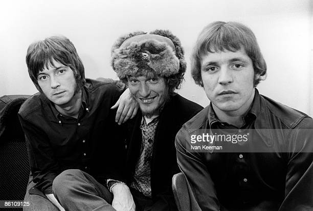GO Photo of Ginger BAKER and CREAM and Eric CLAPTON and Jack BRUCE LR Eric Clapton Ginger Baker Jack Bruce posed studio group shot backstage at...