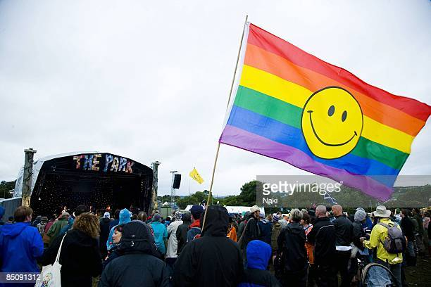 FESTIVAL Photo of GLASTONBURY Crowd at the festival watching the stage rainbow smiley flag