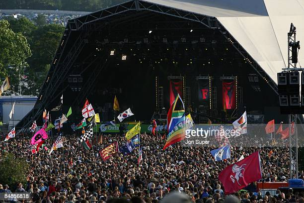 FESTIVAL Photo of GLASTONBURY crowds watching in the audience at the Pyramid Stage at Glastonbury Festival festivals