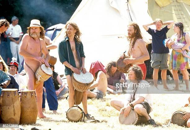 FESTIVAL Photo of GLASTONBURY Festival goers playing drums percussion at Glastonbury Festival