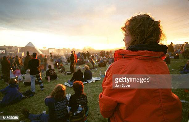 FESTIVAL Photo of GLASTONBURY View of Glastonbury Festival at sunset with Pyramid Stage and crowds in background