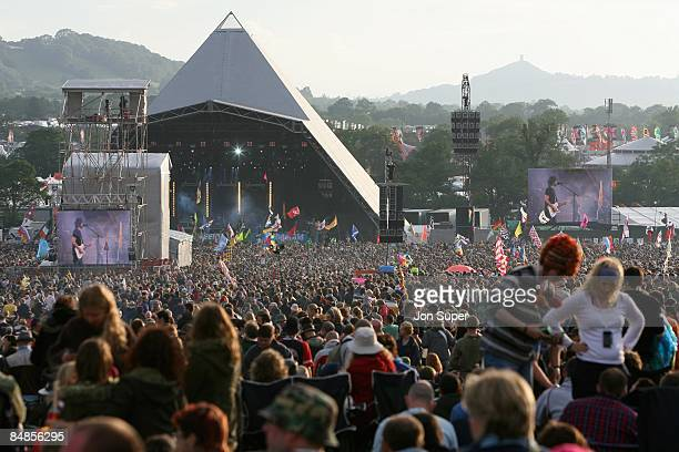 FESTIVAL Photo of GLASTONBURY view of the Pyramid Stage at Glastonbury Festival including crowds and large TV screen concert festivals