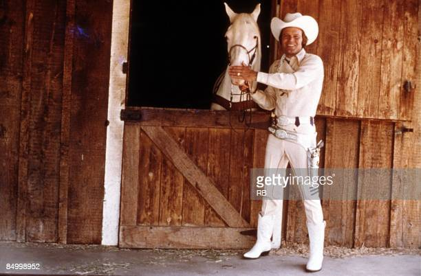 Photo of Glen CAMPBELL; Posed portrait of Glen Campbell, with horse