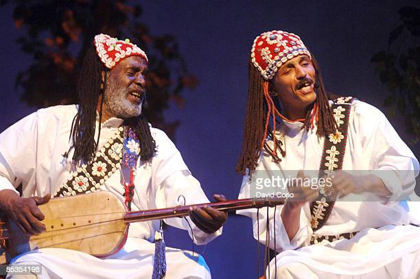 CENTER Photo of GNAWA MASTER MUSICIANS OF MOROCC performing live onstage