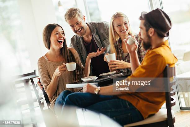 Photo of good friends having coffee together in cafe